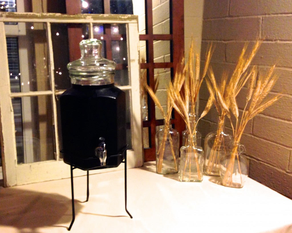 """Since Matt's party had a """"beer tasting"""" twist, I used wheat stalks in old liquor bottles as part of the tablescape.  Always pick one or two elements to repeat throughout the party."""