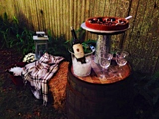 I continued using bales of hay throughout; here I draped it with an IKEA plaid throw to make a sitting area near a drink station.