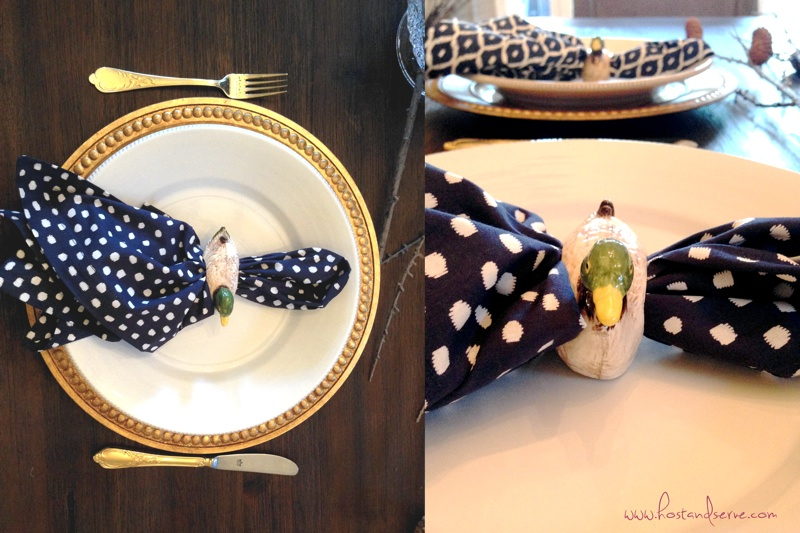 Preppy navy and gold tablescape with ceramic duck rings