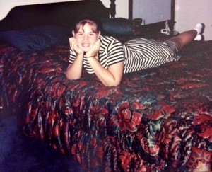 "My 7th grade self, proudly posing on my ""bedspread."""