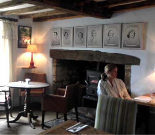 My favorite room- the fireplace is adorned by beautiful photographs of the Mitford sisters