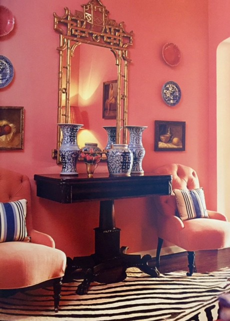 Pink is used as a neutral in fashion designer Jill Roberts's home office. Designer Mary McDonald used English, Chinese, and French antiques accented with a zebra-skin rug and a chinoiserie mirror to create a very glamorous look.