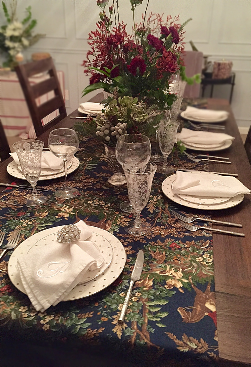 A wide swath of Ralph Lauren fabric serves as a runner and can be used for many other things. Linen napkins are a great investment as you can use them over and over again.