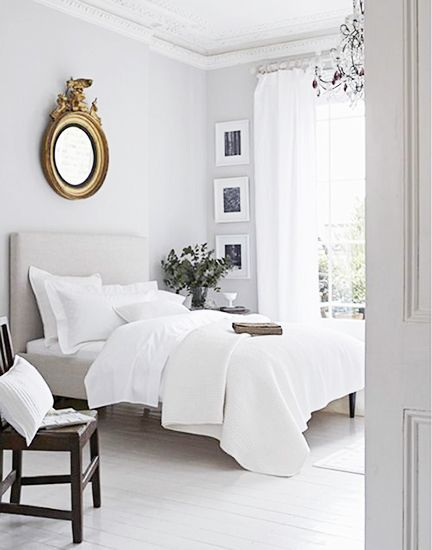 The Federalist mirror above the bed gives this room character and interest. ~from Domainehome