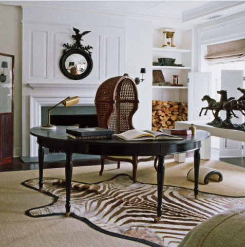 Notice that there is something interesting at three levels: on the wall, the chair, and the zebra rug.