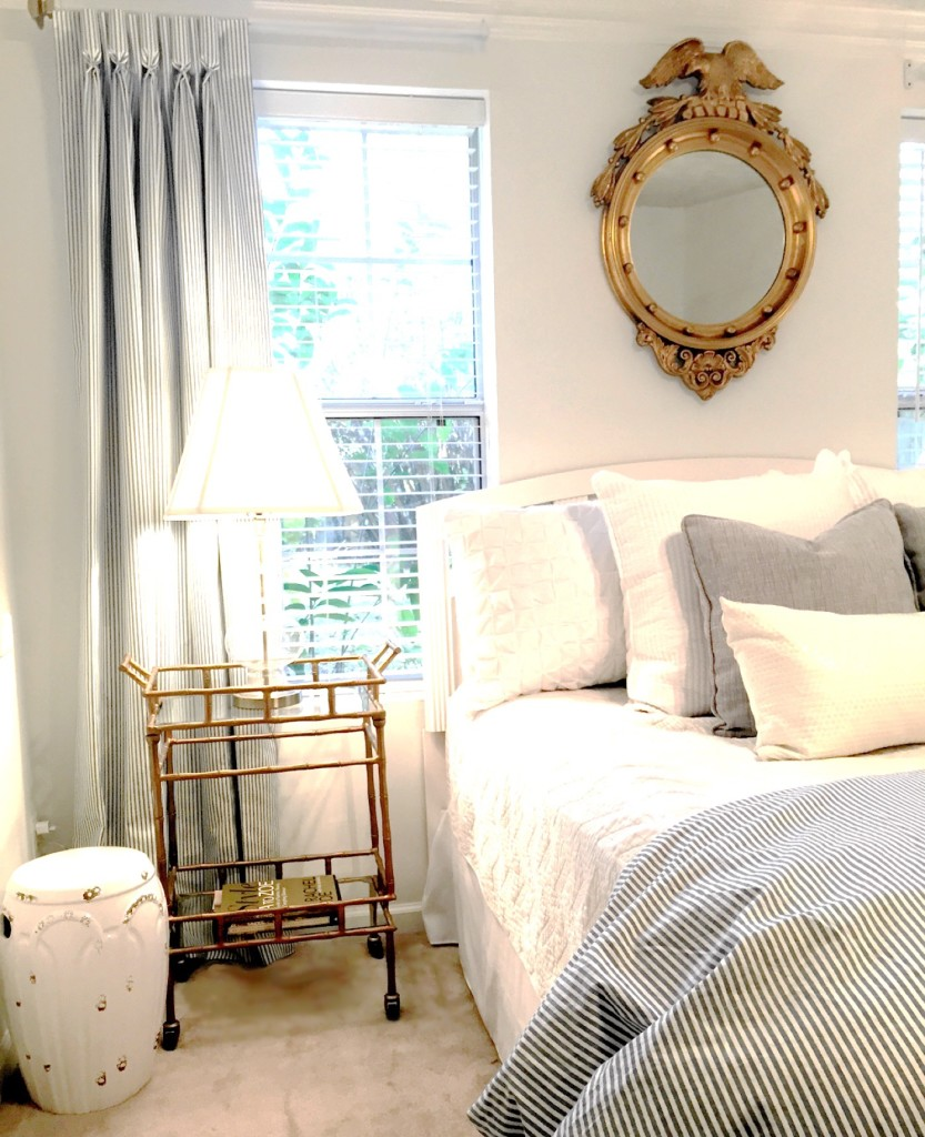 I chose to use a gold bamboo and glass bar cart to add an unexpected touch to the room.