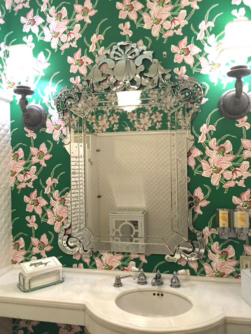 A lovely bathroom at The Colony Hotel in Palm Beach. Note the bright, bold paper paired with the delicate mirror.