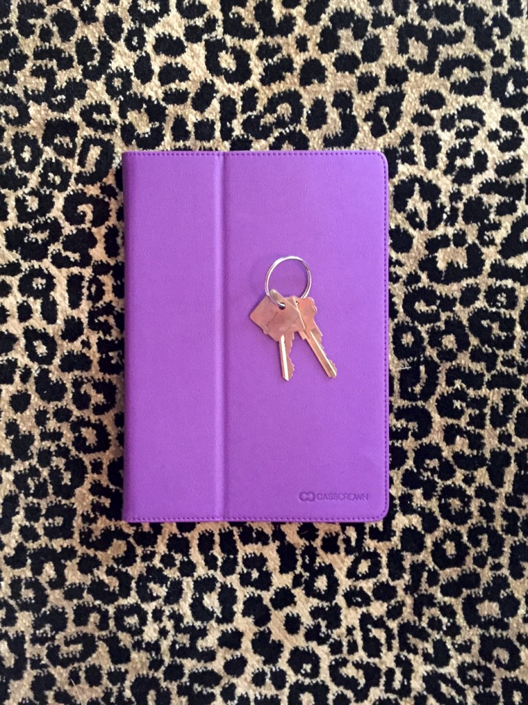 A purple iPad & room keys open your stay at the Gilded Hotel.