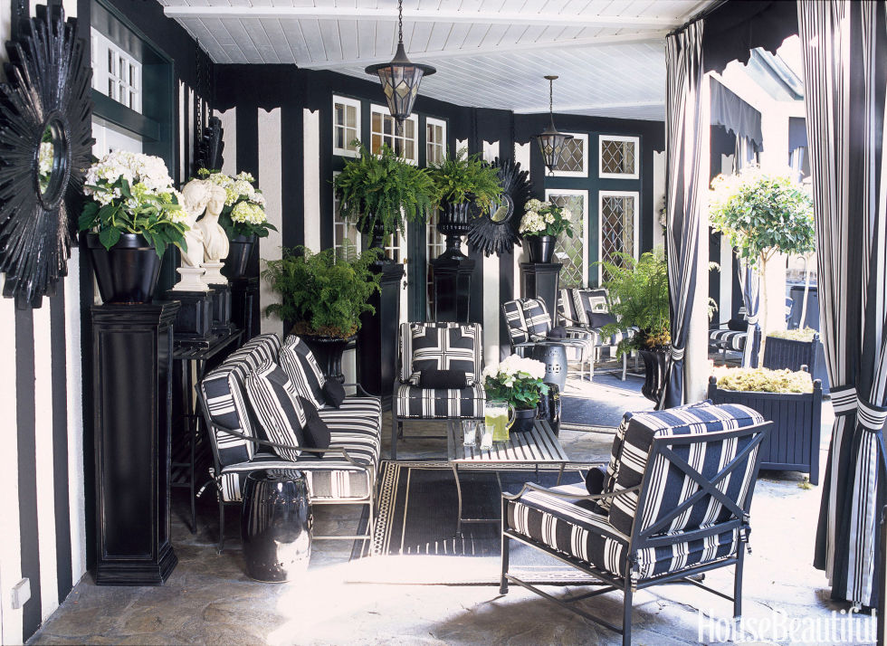 Featured in House Beautiful, Mary McDonald brings the chicness of black and white to the patio