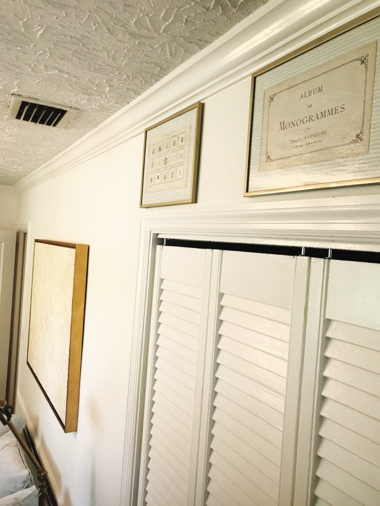 nursery magic atop his closet are three framed pages from an antique parisian album of monograms from the turn of the century purchased at the 2016 art and antiques